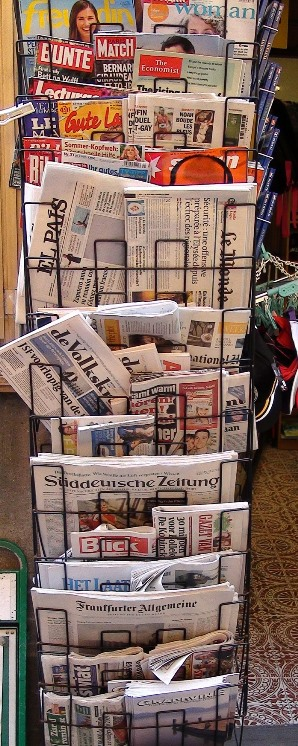 a rack of Europen popular magazines for sale
